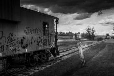 A disused train sits abandoned in a prairie ghost town